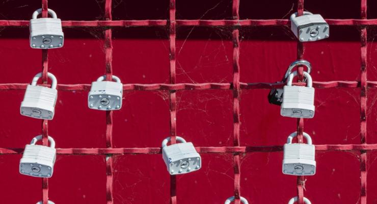 padlocks on a fence